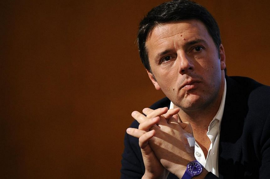 Centre-left leader Matteo Renzi attends a political meeting in Turin in this Dec 6, 2013 file photo.Renzi was nominated Italy's youngest-ever prime minister on Monday, Feb 17, 2014, after wrestling power from his predecessor in a bid to revital