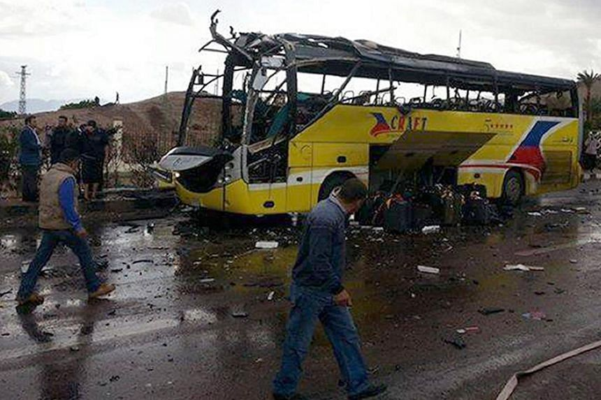 The wreckage of a tourist bus at the site of a bomb explosion in the Egyptian south Sinai resort town of Taba, on Feb 16, 2014. Egyptian police said on Monday, Feb 17, 2014, they believe a suicide bomber triggered the blast in a bus that killed