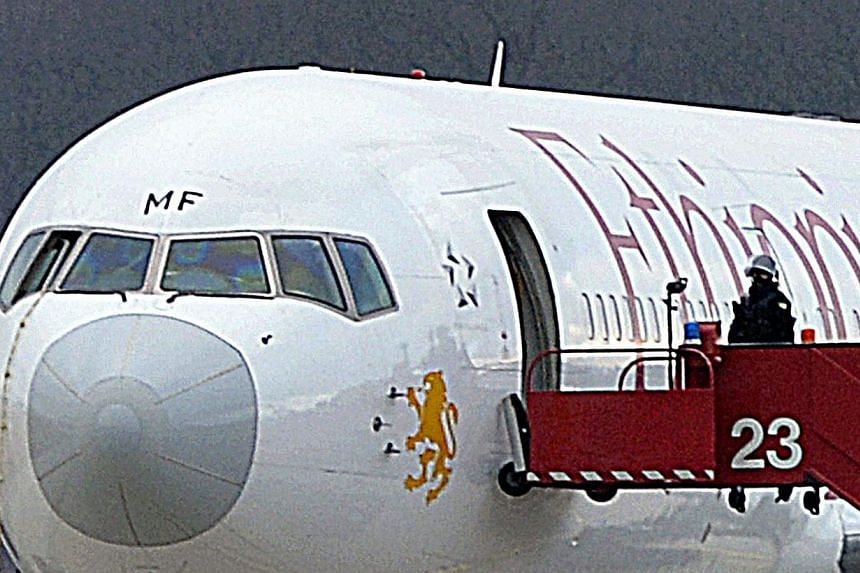 The rope (left) used by the co-pilot of an hijgacked Ethiopian Airlines flight en route to Rome to scale out of the cockpit window, on Feb 17, 2014, at Geneva airport.Ethiopia's government on Monday named the co-pilot of an Ethiopian Airlines f