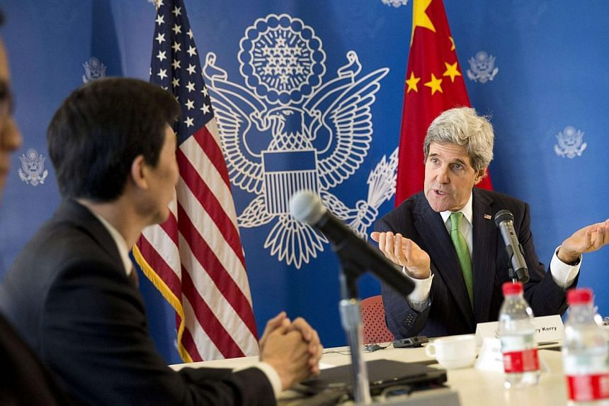 US Secretary of State John Kerry (right) in a discussion with Chinese bloggers in Beijing, on Feb 15, 2014. -- FILE PHOTO: REUTERS