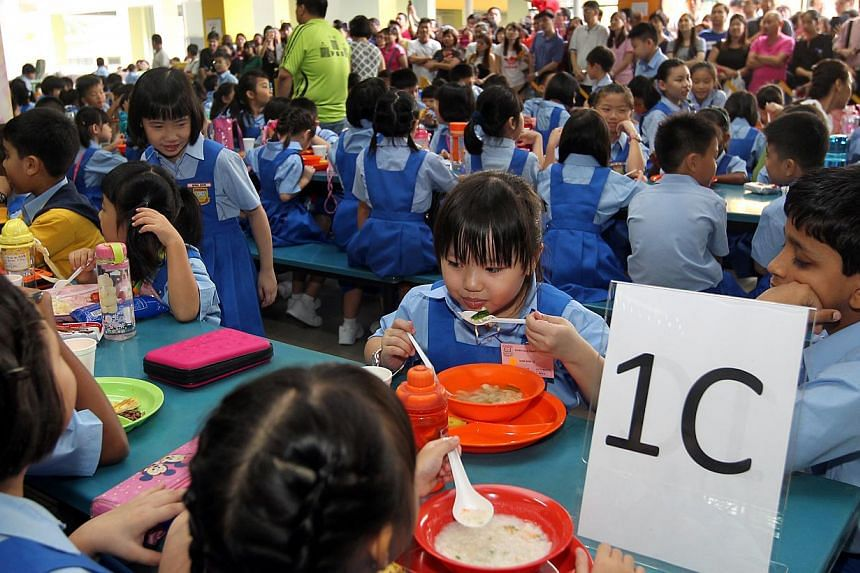 Primary 1 pupils on the first day of school in 2014. Only 45 per cent of Singaporean parents are financially prepared for their children's education, according to a recent survey on financial awareness of families. -- ST FILE PHOTO: SEAH KWANG PENG