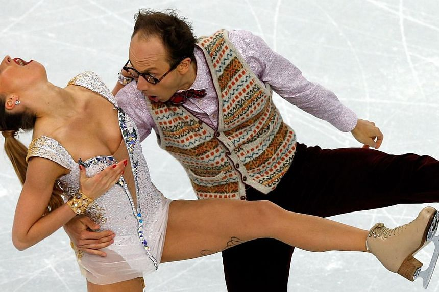 Germany's Alexander Gazsi and Nelli Zhiganshina perform in the Figure Skating Ice Dance Short Dance programme at the Iceberg Skating Palace during the Sochi Winter Olympics on Feb 16, 2014. See more pictures from around the world in Through The Lens'