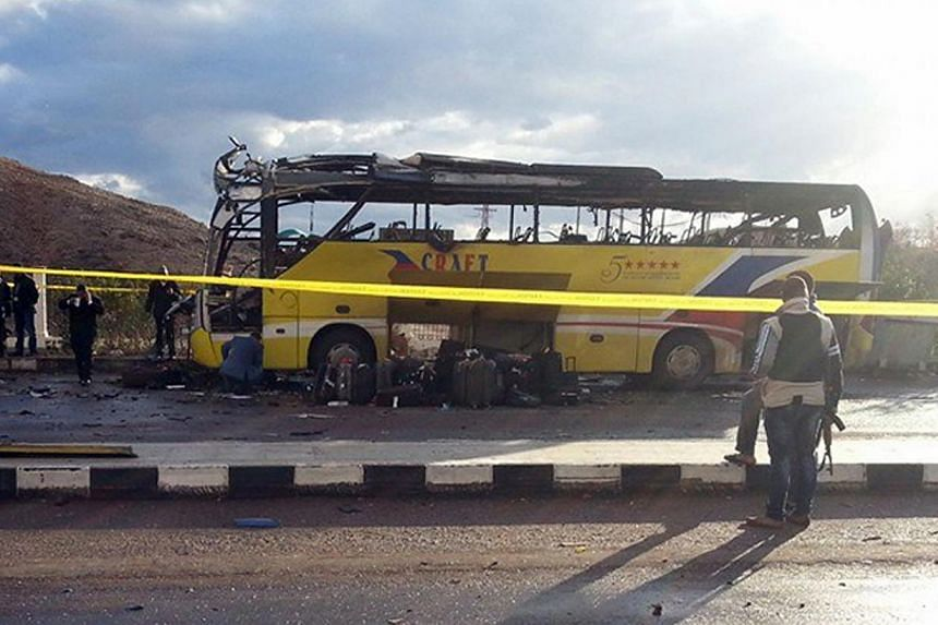 A picture taken on Feb 16, 2014, shows the wreckage of a tourist bus at the site of a bomb explosion in the Egyptian south Sinai resort town of Taba. -- PHOTO: AFP