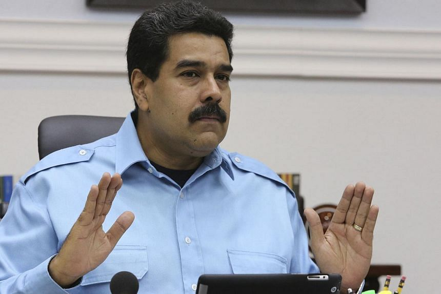 Venezuela's President Nicolas Maduro speaks during a meeting with military high command and ministers at Miraflores Palace in Caracas on Feb 13, 2014. -- FILE PHOTO: REUTERS