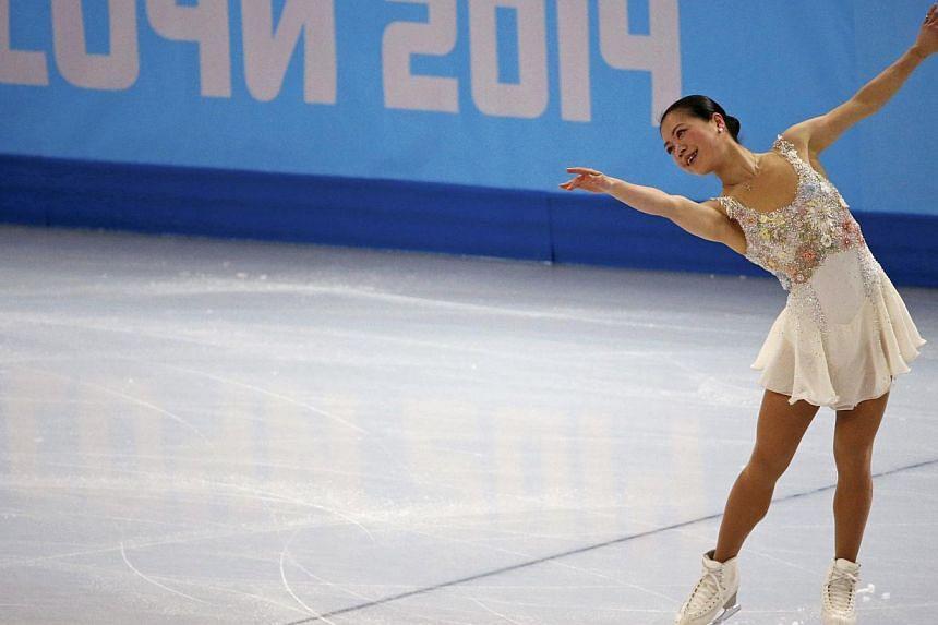 Akiko Suzuki of Japan competes during the figure skating team ladies' free skating at the Sochi 2014 Winter Olympics on Feb 9, 2014. -- PHOTO: REUTERS