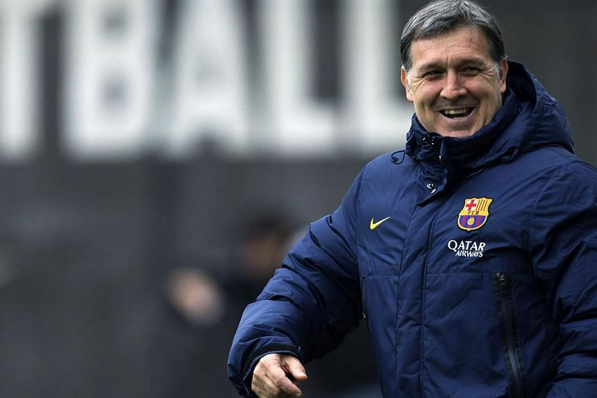 Barcelona's coach Gerardo Martino smiles to his players during a training session at Ciutat Esportiva Joan Gamper in Sant Joan Despi near Barcelona, on Jan 18, 2014. -- FILE PHOTO: REUTERS