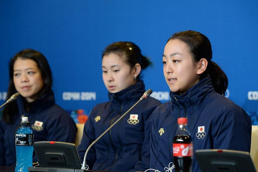 From left, Japan's figure skater Mao Asada speaks as her colleagues Kanako Murakami and Akiko Suzuki listen to during a press conference at the Iceberg Skating Palace during the Sochi Winter Olympics in Sochi on February 17, 2014.Scary mums are