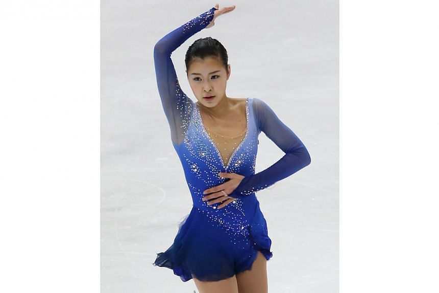 Kanako Murakami of Japan performs in the ladies free skating during the International Skating Union Four Continents Figure Skating Championships in Taipei, on Jan 25, 2014. -- FILE PHOTO: AFP