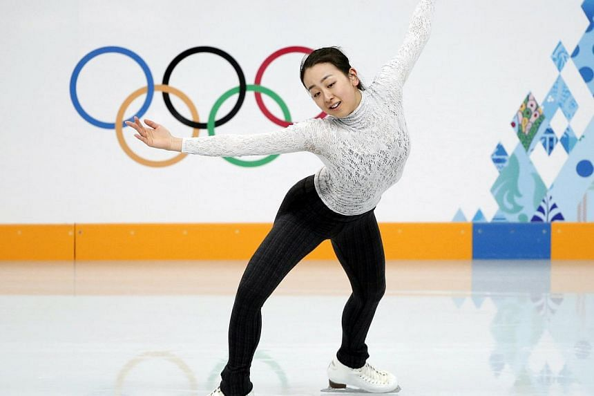 Mao Asada of Japan practises her routine during a figure skating training session at the Iceberg Skating Palace training arena during the 2014 Sochi Winter Olympics on Feb 17, 2014. -- PHOTO: REUTERS