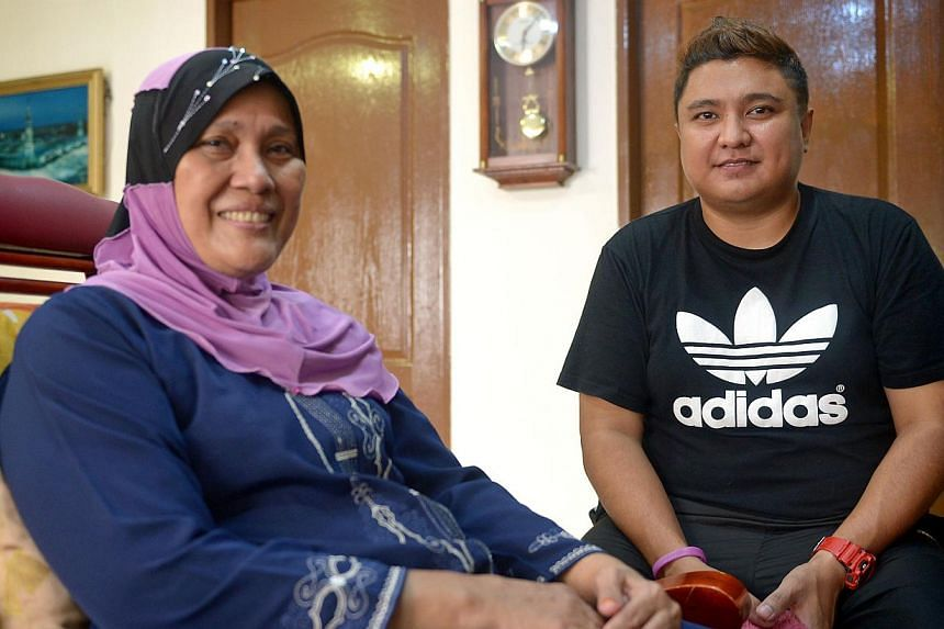 Mr Faizaltulamri Noorali with Ms Hasnah Shasdan, whom he helped evacuate from the fire. Among the others he took to safety was a 76-year-old woman who uses a wheelchair; he carried her down 11 flights of stairs. -- ST PHOTO: NG SOR LUAN