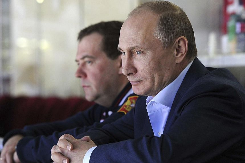 Russian President Vladimir Putin (right) and Prime minister Dmitry Medvedev watch Russia's national ice hockey team play Slovakia during the Sochi 2014 Olympic Winter Games at the Bolshoy Ice Dome on Feb 16, 2014. -- FILE PHOTO: REUTERS