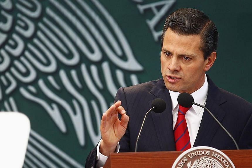 Mexico's President Enrique Pena Nieto speaks during the promulgation of the electoral political reform in Mexico City, Jan 31, 2014. Mexico's president hosts the leaders of the United States and Canada on Wednesday, with the North American neighbors