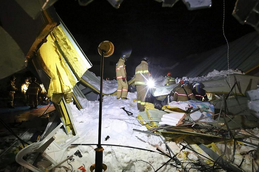 Firefighters search for survivors among debris from the collapsed resort building in Gyeongju, south of Seoul, on Feb 18, 2014. -- PHOTO: REUTERS