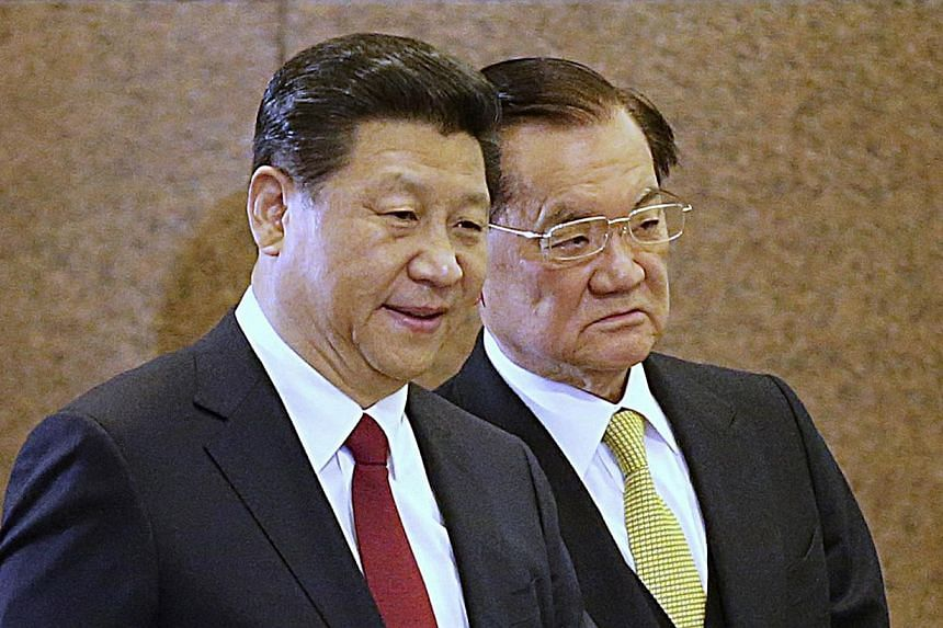 Mr Xi Jinping, the General Secretary of the Communist Party of China Central Committee (L) walks with visiting Honorary Chairman of the Kuomintang Lien Chan to a meeting at the Diaoyutai State Guesthouse in Beijing on February 18, 2014. -- PHOTO: REU