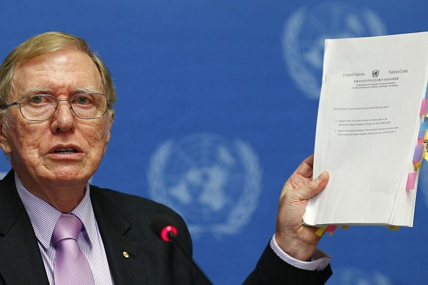 Michael Kirby, Chairperson of the Commission of Inquiry on Human Rights in North Korea holds a copy of his report during a news conference at the United Nations in Geneva, Feb 17, 2014.China said on Tuesday, Feb 18, 2014, that it cannot accept