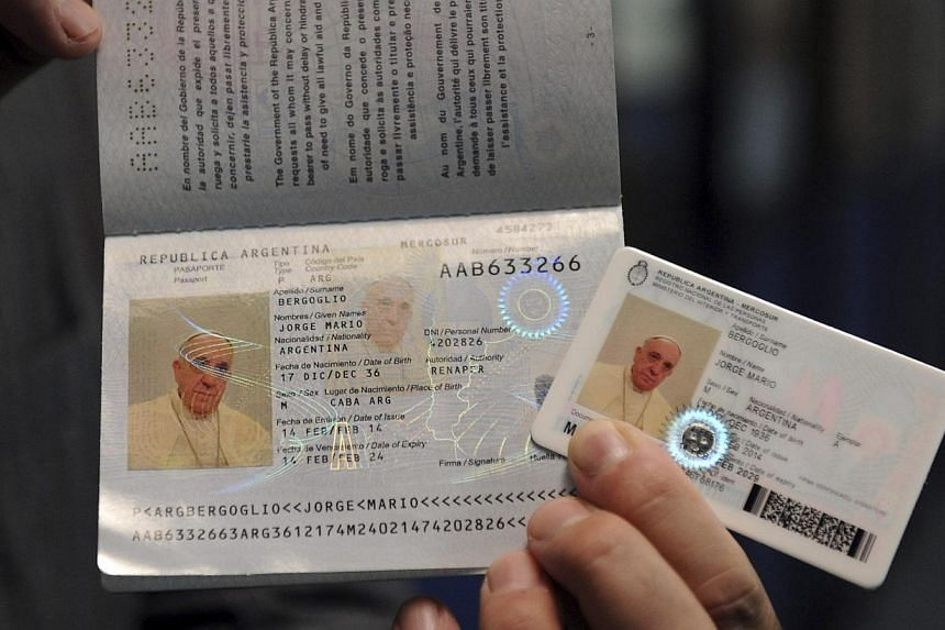 Pope Francis' new national identification card and passport are seen in this undated handout photo taken by Argentina's Interior Ministry and distributed on Feb 17, 2014. -- PHOTO: REUTERS