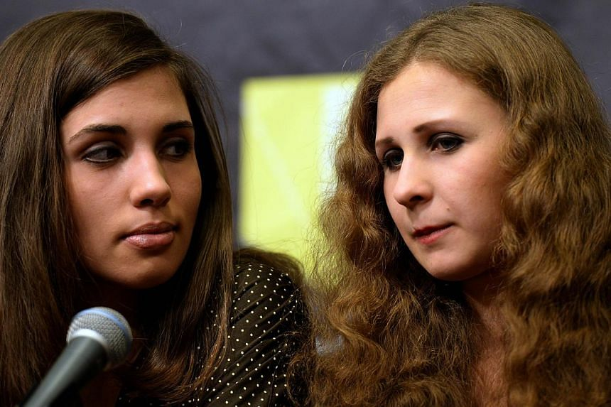 Two members of Russian punk group Pussy Riot who were released from prison colonies late last year said they had both been arrested on Tuesday in downtown Sochi during the Olympic Games. -- FILE PHOTO: AFP