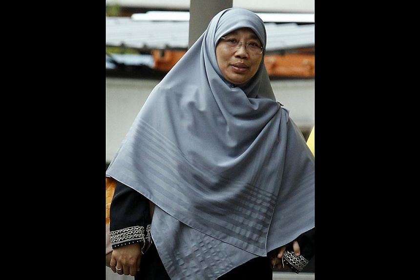 The case of former childcare teacher Siti Hadijah Mohamed Sin who allegedly broke the leg of a two-year-old boy will now go for a pre-trial conference on March 17. -- ST FILE PHOTO:WONG KWAI CHOW
