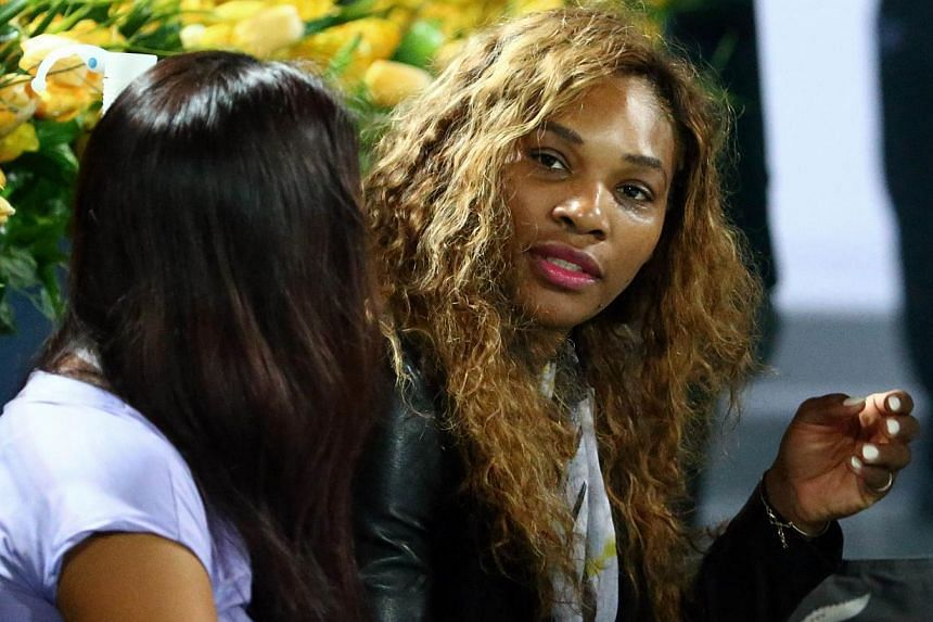 Serena Williams (right), who has been unable to play for a month since hurting her back at the Australian Open, denies on Feb 17, 2014, that age is catching up with her. -- PHOTO: AFP