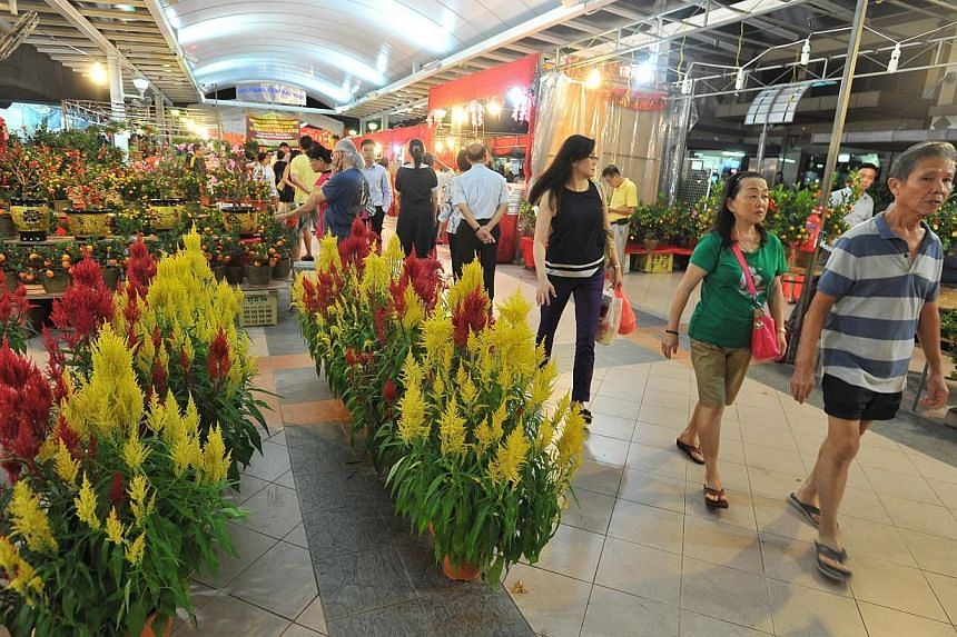 Aljunied-Hougang-Punggol East Town Council (AHPETC), which has been charged in court with offence of holding a Chinese New Year fair in Hougang Central without a licence, is claiming trial. -- FILE PHOTO:LIM YAOHUI FOR THE STRAITS TIMES