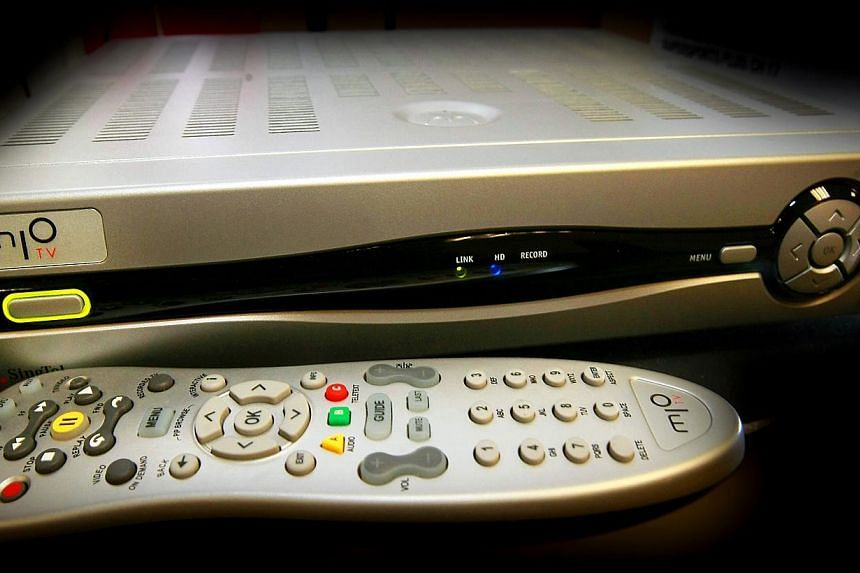The Government is planning to roll out an assistance scheme for low-income families to ensure that they will continue to receive free-to-air TV channels when the nation switches to digital broadcasting by 2020. -- TNP FILE PHOTO: KELVIN CHNG