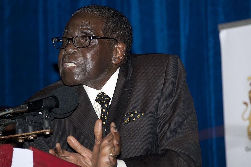 Zimbabwe President Robert Mugabe is in Singapore for an eye operation ahead of his 90th birthday on Friday, Feb 21, 2014, a spokesman said, maintaining a government denial that the long-serving ruler is suffering from prostate cancer. -- FILE PHOTO: