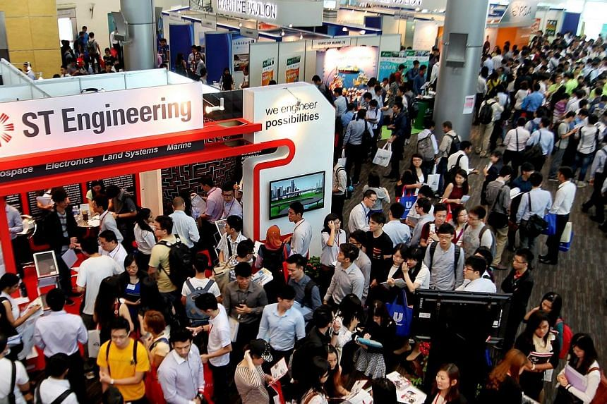 More than 4000 jobs are available at the Nanyang Technological University (NTU) 2014 Career Fair, with a record 223 organisations participating. -- ST PHOTO:LAU FOOK KONG