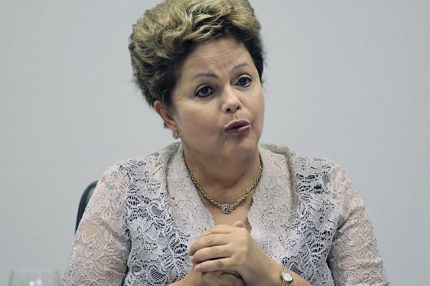 Brazil's President Dilma Rousseff said on Tuesday that she plans to invite Pope Francis, an avid football fan, to attend the World Cup tournament that gets underway in June. -- FILE PHOTO: REUTERS