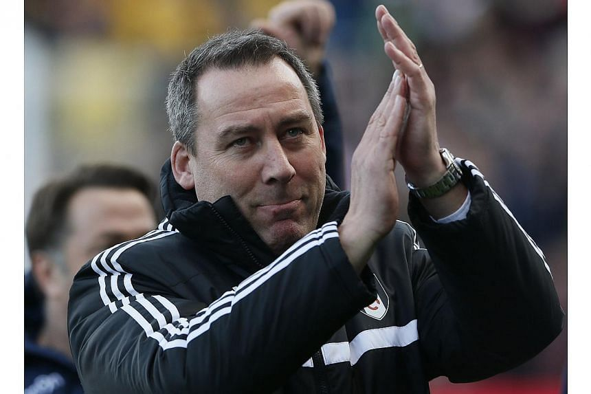 Fulham manager Rene Meulensteen reacts ahead of their English Premier League soccer match against Aston Villa at Craven Cottage in London, on Dec 8, 2013. Premier League strugglers Fulham bowed to the inevitable on Tuesday by confirming the depa
