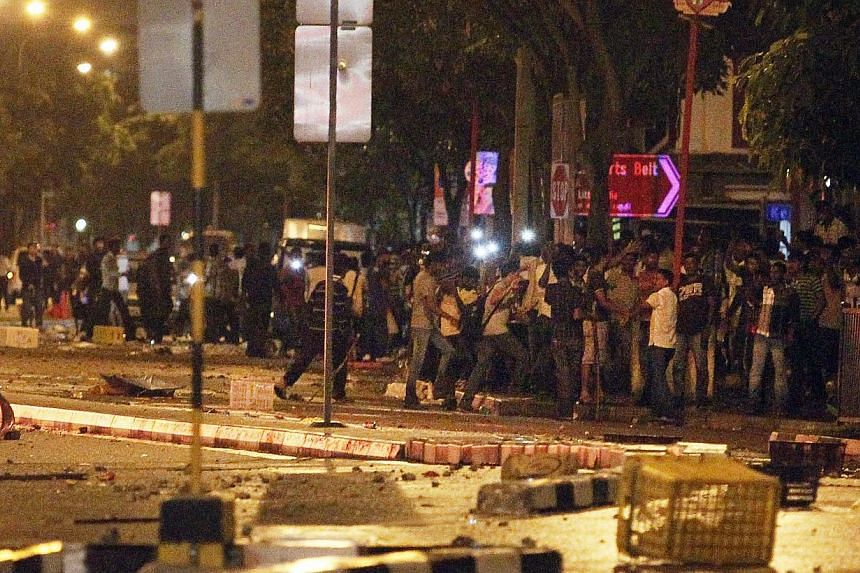 The Little India riot along Race Course Road on Dec 8, 2013. -- ST FILE PHOTO: MARK CHEONG