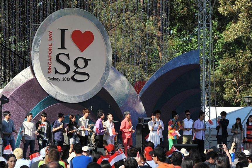 A section of the crowd watching performers at last year's Singapore Day event, which was held in Sydney. The annual event, organised by the Overseas Singaporean Unit under the Prime Minister's Office, aims to keep citizens overseas emotionally connec