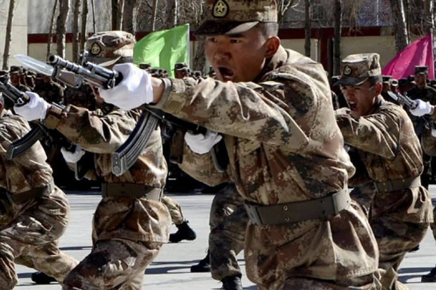 China's soldiers in Lhasa, Tibet autonomous region, participate in a military skills competition. Changes in the average physique of Chinese soldiers over the past 20 years have created a need for newer and larger armaments. -- PHOTO:
