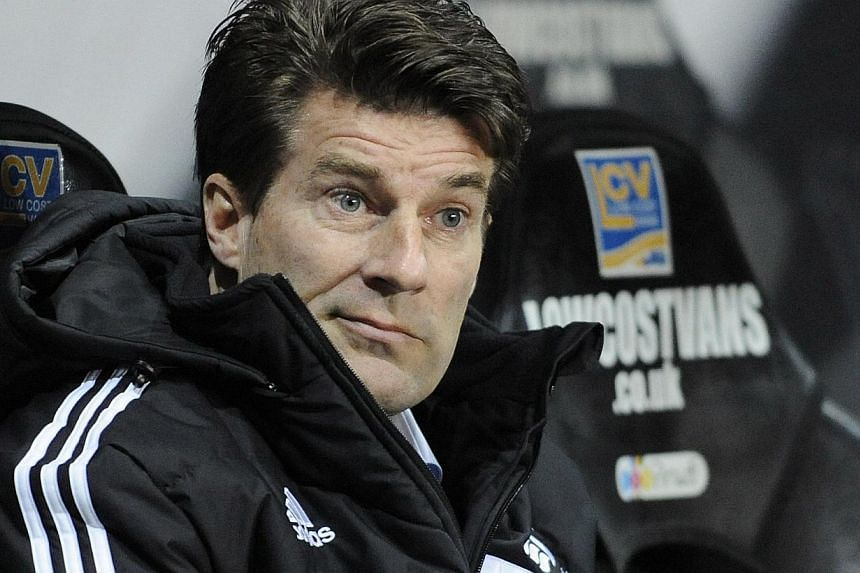 """Former Swansea manager Michael Laudrup continued to hit out at his """"silly"""" and """"incredible"""" sacking by the Premier League club on Tuesday as he vowed to maintain his legal action against the Welsh side. -- FILE PHOTO: REUTERS"""