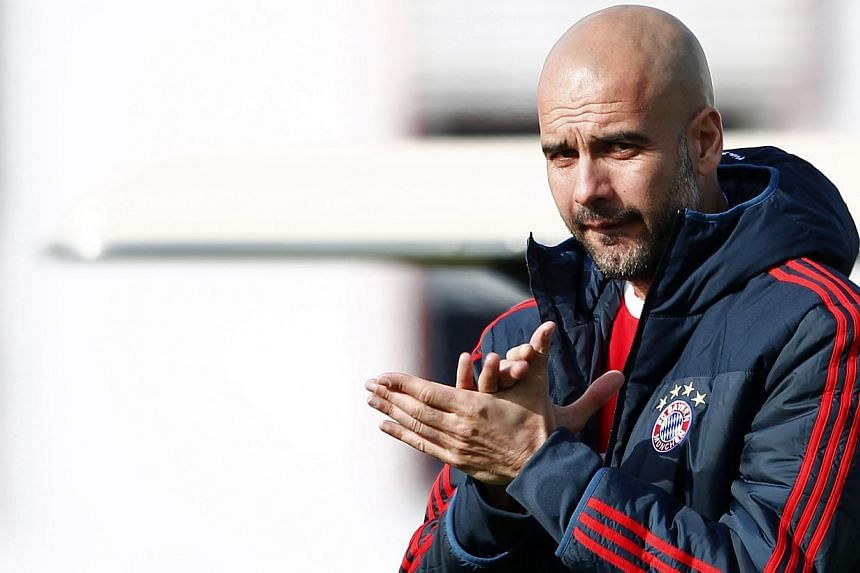 """Pep Guardiola (above) believes Arsenal have the potential to make his Bayern Munich side """"suffer"""" when the Champions League holders return to the Emirates Stadium for the first leg of their last 16 tie on Wednesday. -- PHOTO: REUTERS"""