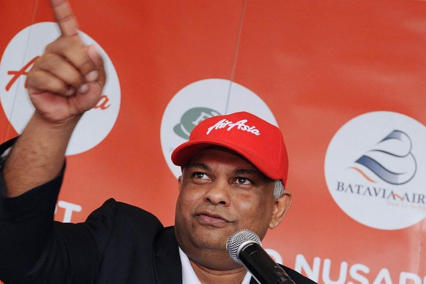 Flamboyant AirAsia boss Tony Fernandes savaged state-backed flag carrier Malaysian Airlines and the nation's aviation authorities on Wednesday, Feb 19, 2014, accusing them of mismanagement that was harming the travelling public. -- FILE PHOTO: AFP