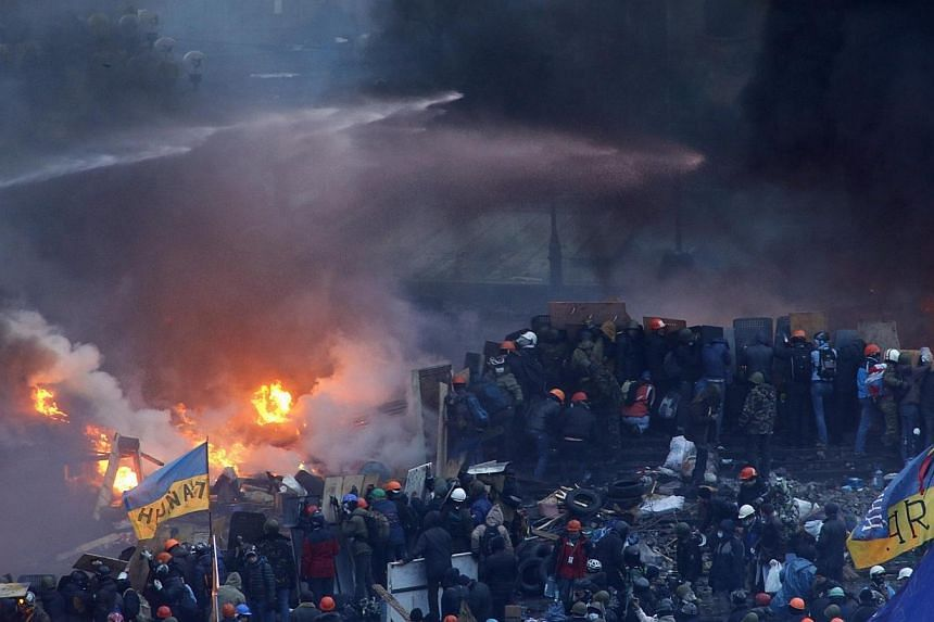 A general view shows clashes at Independence Square in Kiev, on Wednesday, Feb 19, 2014.At least 25 people have died in fierce clashes between anti-government protesters and police in Kiev, the health ministry said in a statement on Wedne
