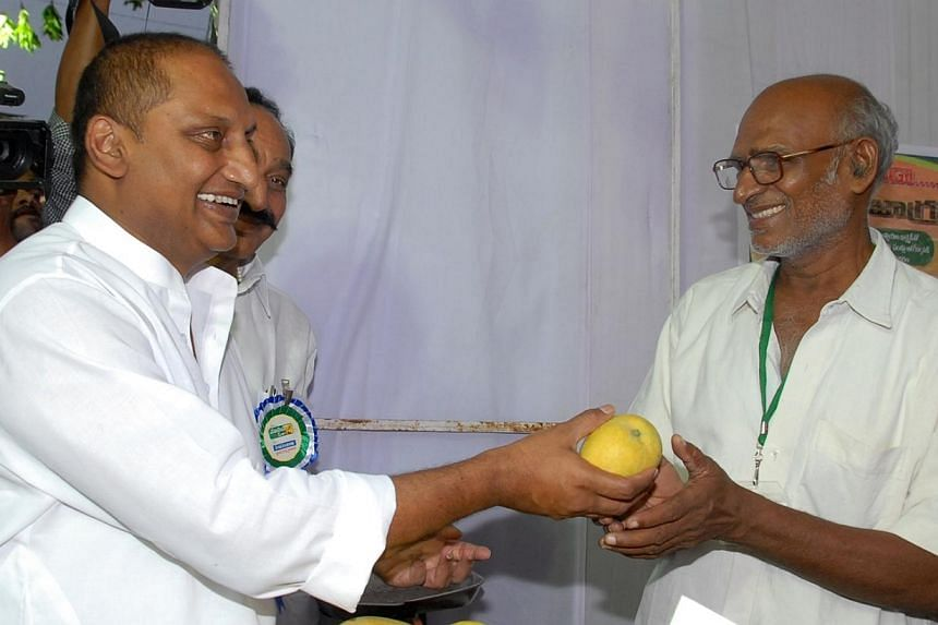 Andhra Pradesh chief minister N. Kiran Kumar Reddy (left) inaugurated a 10-day Mango Mela (fair) at Exhibition Grounds, Hyderabad on May 7, 2013.The chief minister of an Indian state resigned on Wednesday, Feb 19, 2014, in protest at a contenti
