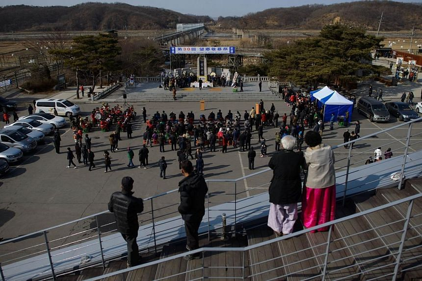 A general view shows a memorial service held by South Korea's Unification Ministry for families with relatives in North Korea, at the Demilitarized Zone (DMZ) at Imjingak, Paju, in South Korea's Gyeonggi Province on Jan 31, 2014. Seoul's top off