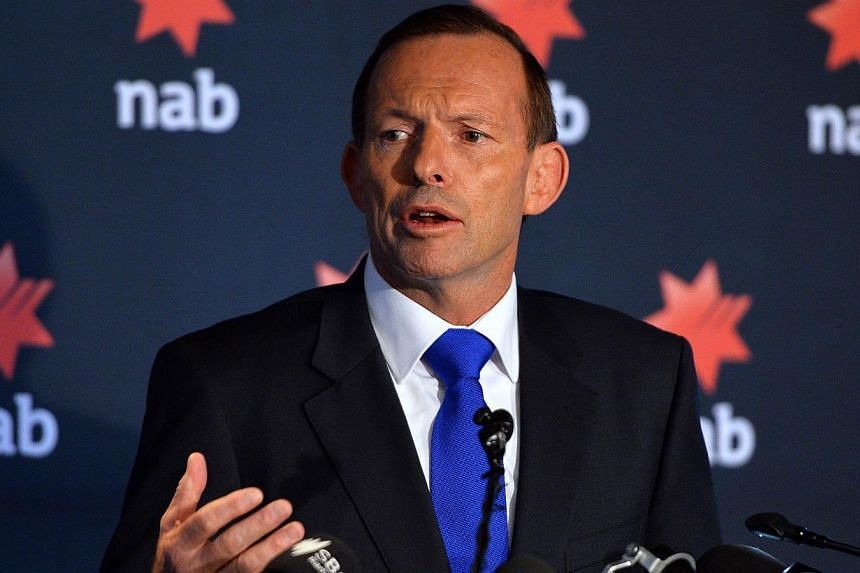 Australia's Prime Minister Tony Abbott speaks at the National Australia Bank's 2014 Reconciliation Action Plan launch in Sydney on Feb 20, 2014. -- PHOTO: AFP
