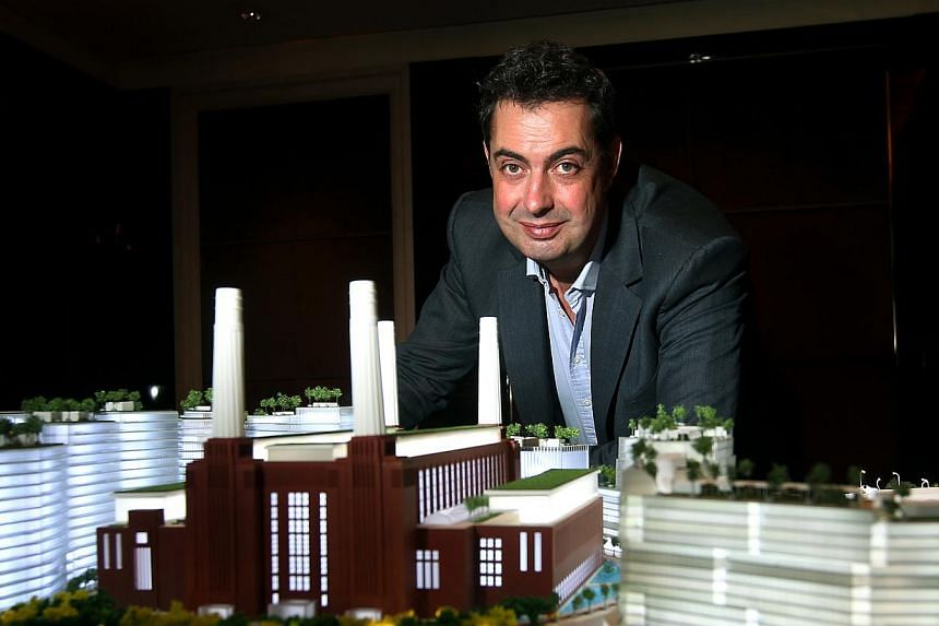 File picture of Mr Rob Tincknell, chief executive of Battersea Power Station Development Company, with a model of the Battersea Power Station project. --PHOTO: SPH