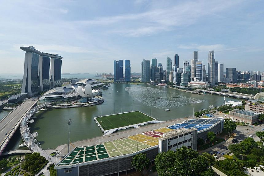 Aerial view of the Singapore Marina Bay city skyline, showing the Marina Bay Sands (left), the Marina Bay Financial Centre (centre) and the Central Business District skyscrapers (right). --PHOTO: SPH