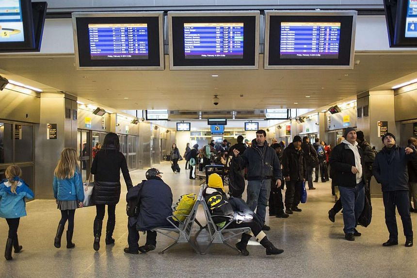 Travellers are seen at John F. Kennedy International airport in the Queens borough of New York, on Feb 14, 2014. -- FILE PHOTO: REUTERS