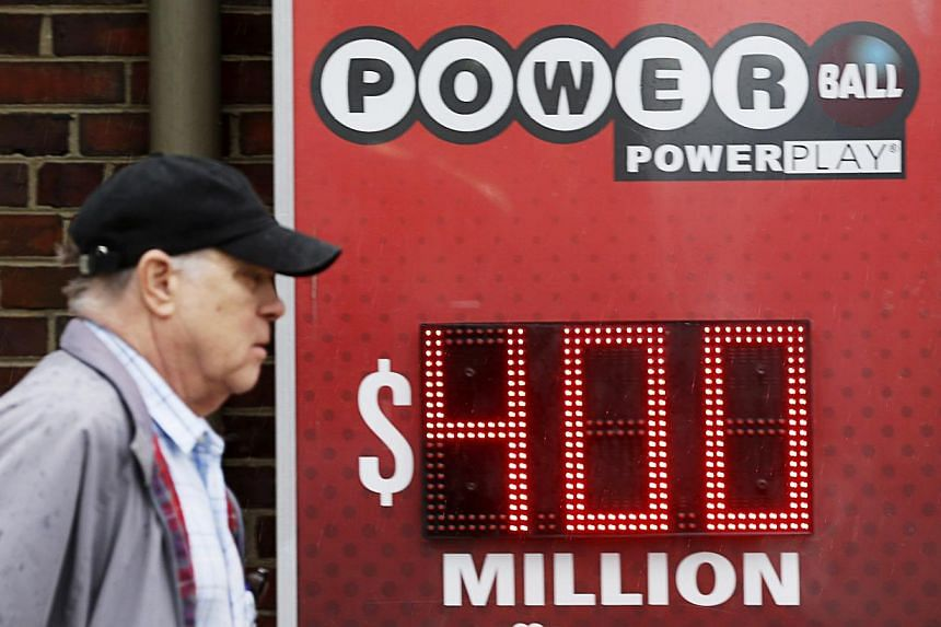A man walks by a sign advertising Virginia's $400 million Powerball lottery in Arlington, Virginia, on Feb 19, 2014.-- PHOTO: REUTERS