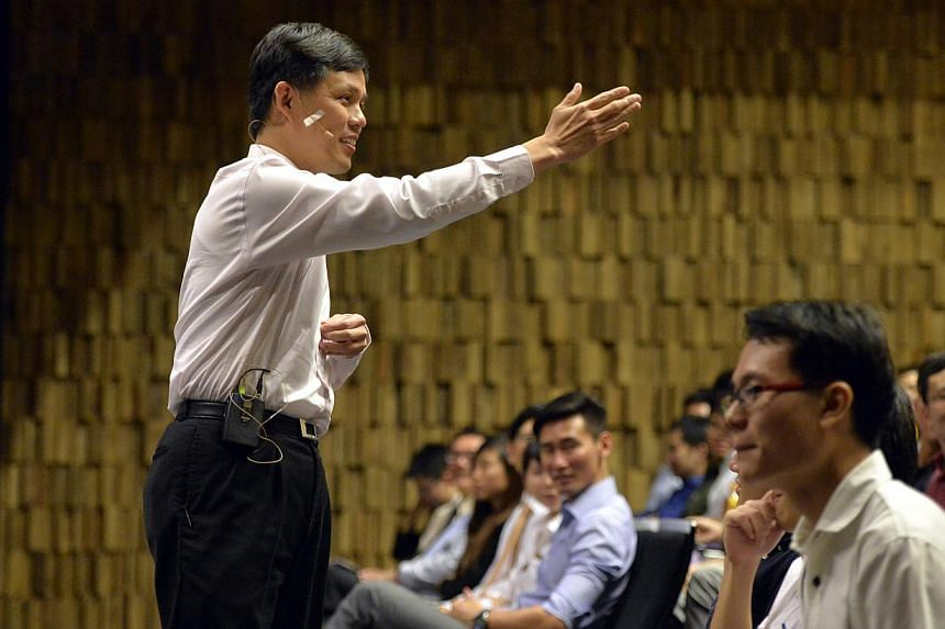 Mr Chan addressing the audience during the forum organised by the National University of Singapore Students' Political Association at the Ngee Ann Kongsi Auditorium, NUS University Town, yesterday.
