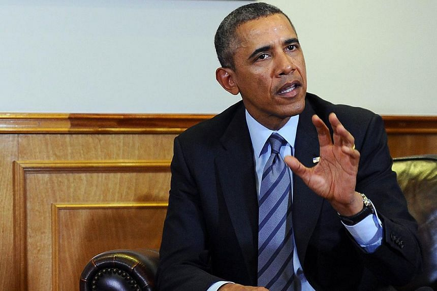 After an art history professor took offence at a comment he made last month, US President Barack Obama sought to make amends - with a handwritten note of apology. -- PHOTO: AFP