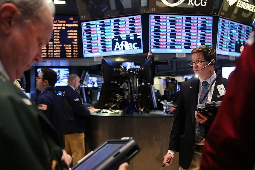 Traders work on the floor of the New York Stock Exchange on Feb 10, 2014 in New York City. -- FILE PHOTO: AFP