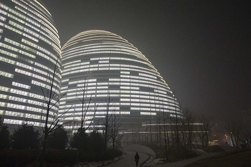 China's capital Beijing issued an emergency pollution alert for the first time on Thursday, Feb 20, 2014, warning residents to reduce outdoor activities and construction sites to control dust given a forecast of heavy smog over the next three days. -