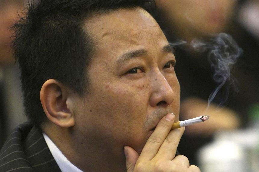 """Former chairman of Hanlong MiningLiu Han at a conference in Mianyang, Sichuan province, on March 21, 2008.Prosecutors in central China on Thursday, Feb 20, 2014, charged Liu with murder, gun-running and other crimes as part of a """"mafia-st"""