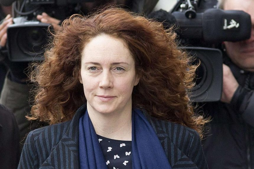 Rebekah Brooks arrives at the Old Bailey courthouse in London, Feb 19, 2014. The jury trying Brooks over phone-hacking charges should not hold her role as a former Rupert Murdoch editor with huge political influence against her, her lawyer said,