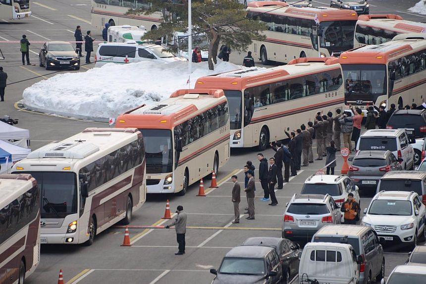 Buses carrying attendees of a family reunion between North and South Korea leave the hotel in the eastern port city of Sokcho on Feb 20, 2014. -- PHOTO: AFP